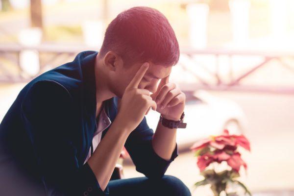 Man Suffering From Stress Headache