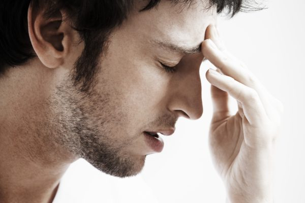 Man in Pain from a Cluster Headache